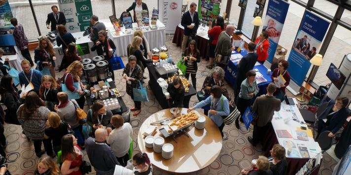 OMA Conference Exhibitors with Delegates at a Networking Break