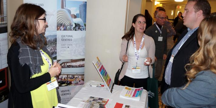 Exhibitors Informing Delegates of the Services They Offer