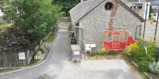 View of Exhibit Hall and Railway route taken from the Cottage