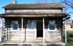 See how the early settlers lived in the Sherk log cabin